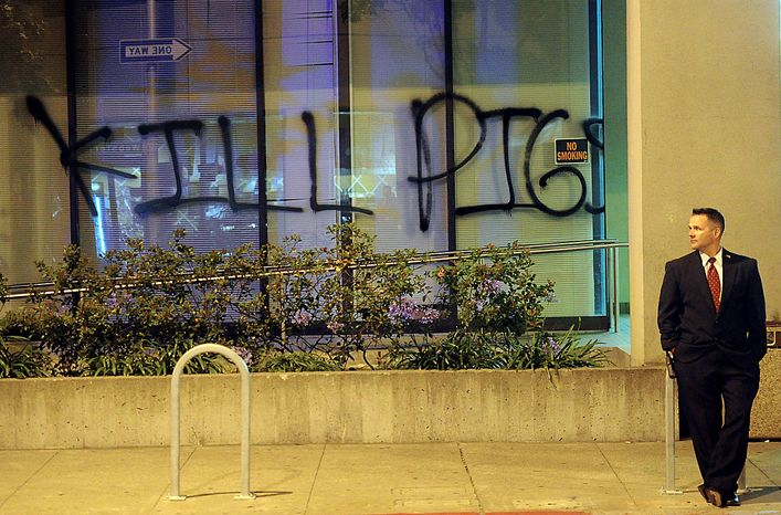Graffiti marks an Oakland, Calif., office building after demonstrations on Friday, July 9, 2010. Sparked by an involuntary manslaughter verdict for Johannes Mehserle, a transit police officer accused of killing an unarmed Oscar Grant on New Year's Day 2009, hundreds of protesters took to the streets Thursday evening. (AP Photo/Noah Berger)