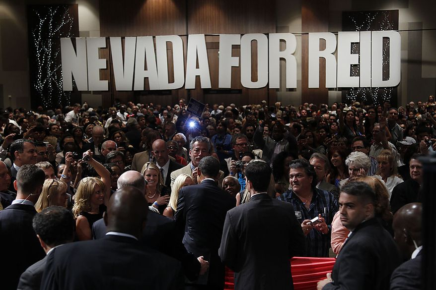 President Barack Obama, center, shakes hands with supporters after speaking at a campaign fundraiser for Senate Majority Leader Harry Reid D-Nev., in Las Vegas, Thursday, July 8, 2010.(AP Photo/Pablo Martinez Monsivais)