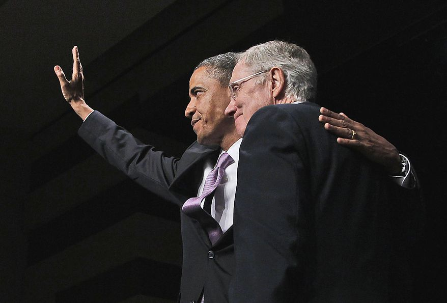 President Barack Obama, left, waves at a campaign fundraiser for Senate Majority Leader Harry Reid D-Nev., right, in Las Vegas, Thursday, July 8, 2010.(AP Photo/Pablo Martinez Monsivais)