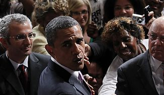 President Barack Obama greets supporters after speaking at a campaign fundraiser for Senate Majority Leader Harry Reid D-Nev., in Las Vegas, Thursday, July 8, 2010.(AP Photo/Pablo Martinez Monsivais)