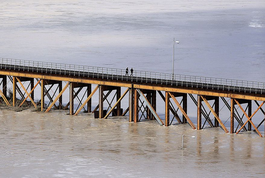 A swollen Rio Grande, driven by dam releases upstream and rain-swollen tributaries following last week's Hurricane Alex, pushes against a railroad crossing, July 9, 2010, in Laredo, Texas. The river has crested, but is not expected to drop for several days. (AP Photo/Eric Gay)