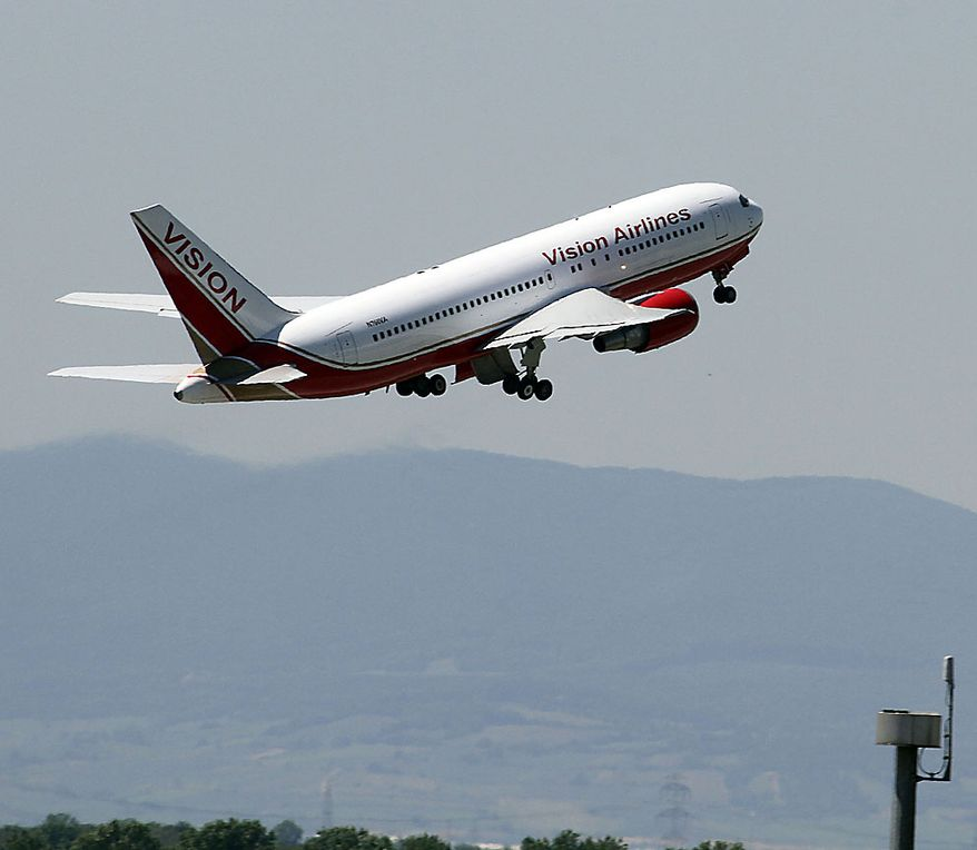 A U.S. plane believed to be carrying candidates for a 14-person spy swap as part of the largest spy swap since the Cold War starts from Vienna's Schwechat airport in Austria on Friday, July 9, 2010. (AP Photo/Ronald Zak)