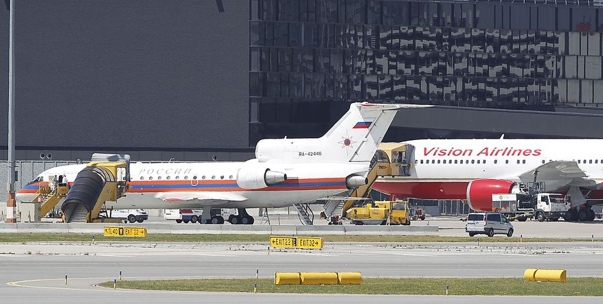 A U.S., rear, and a Russian plane, front, believed to be carrying candidates for a 14-person spy swap as part of the largest spy swap since the Cold War have parked on the tarmac at Vienna's Schwechat airport on Friday, July 9, 2010. (AP Photo/Matthias Schrader)