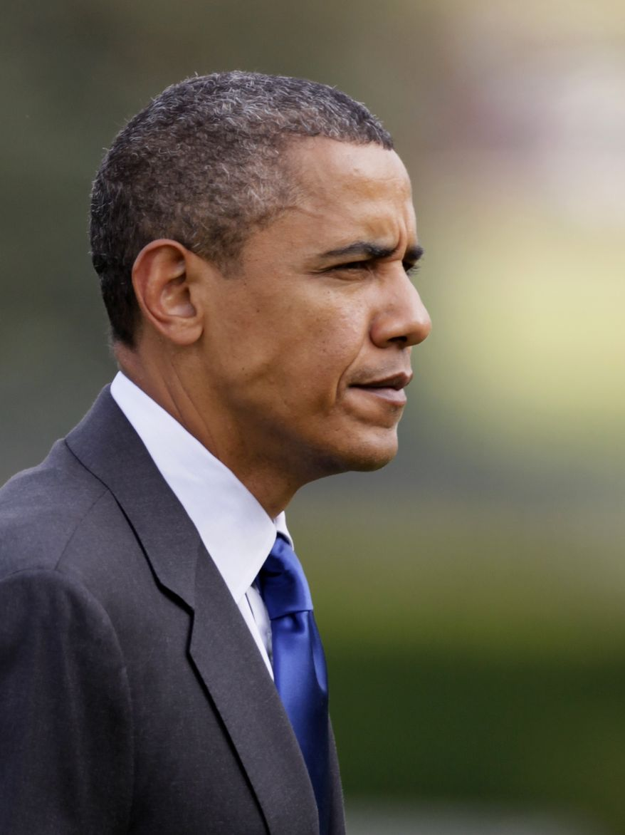 President Barack Obama walks across the South Lawn of the White House after stepping off of Marine One in Washington, Friday, July 9, 2010. (AP Photo/Carolyn Kaster)