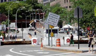 A sign warns vehicles that Park Row in lower Manhattan is closed to traffic. After the Sept. 11, 2001, terror attacks, the New York Police Department barricaded off its headquarters. About 2,000 residents in two nearby apartment complexes found themselves living inside a security zone. (Associated Press)