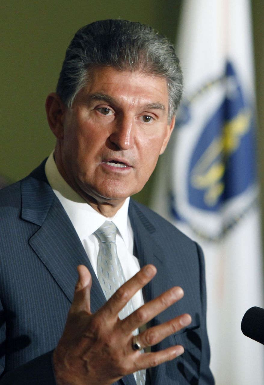 "West Virginia Gov. Joe Manchin III, a Democrat, speaks during a news conference at the opening of the annual meeting of the National Governors Association on Friday, July 9, 2010, in Boston. Mr. Manchin said that ""it's highly likely"" that he will run for the late Robert C. Byrd's Senate seat. (AP Photo/Michael Dwyer)"