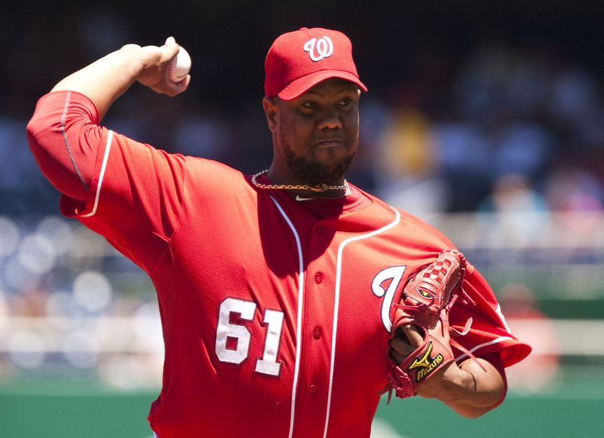 ASSOCIATED PRESS Washington Nationals starter Livan Hernandez delivers a pitch during the first inning of a baseball game against the San Francisco Giants, Sunday, July 11, 2010, in Washington.