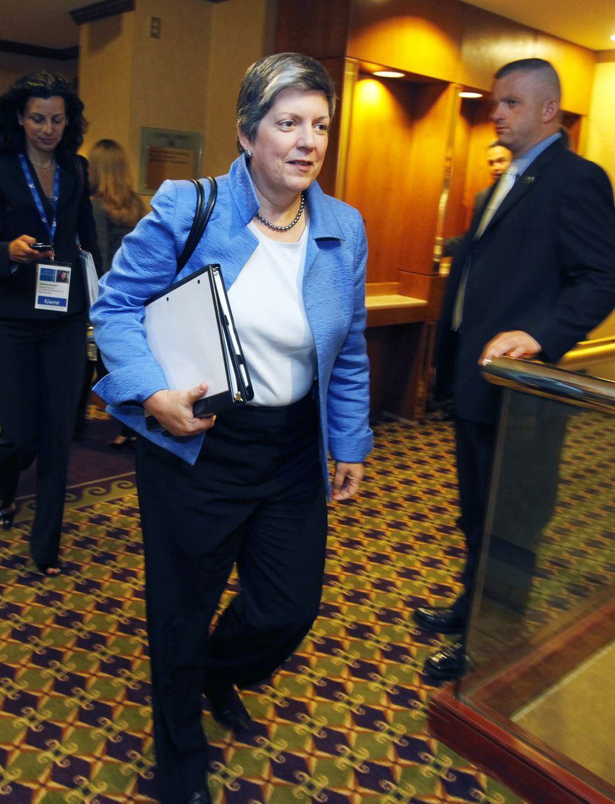 Secretary of Homeland Security Janet Napolitano leaves a private meeting with Arizona Gov. Jan Brewer at the annual meeting of the National Governors Association on Sunday, July 11, 2010, in Boston. (AP Photo/Michael Dwyer)