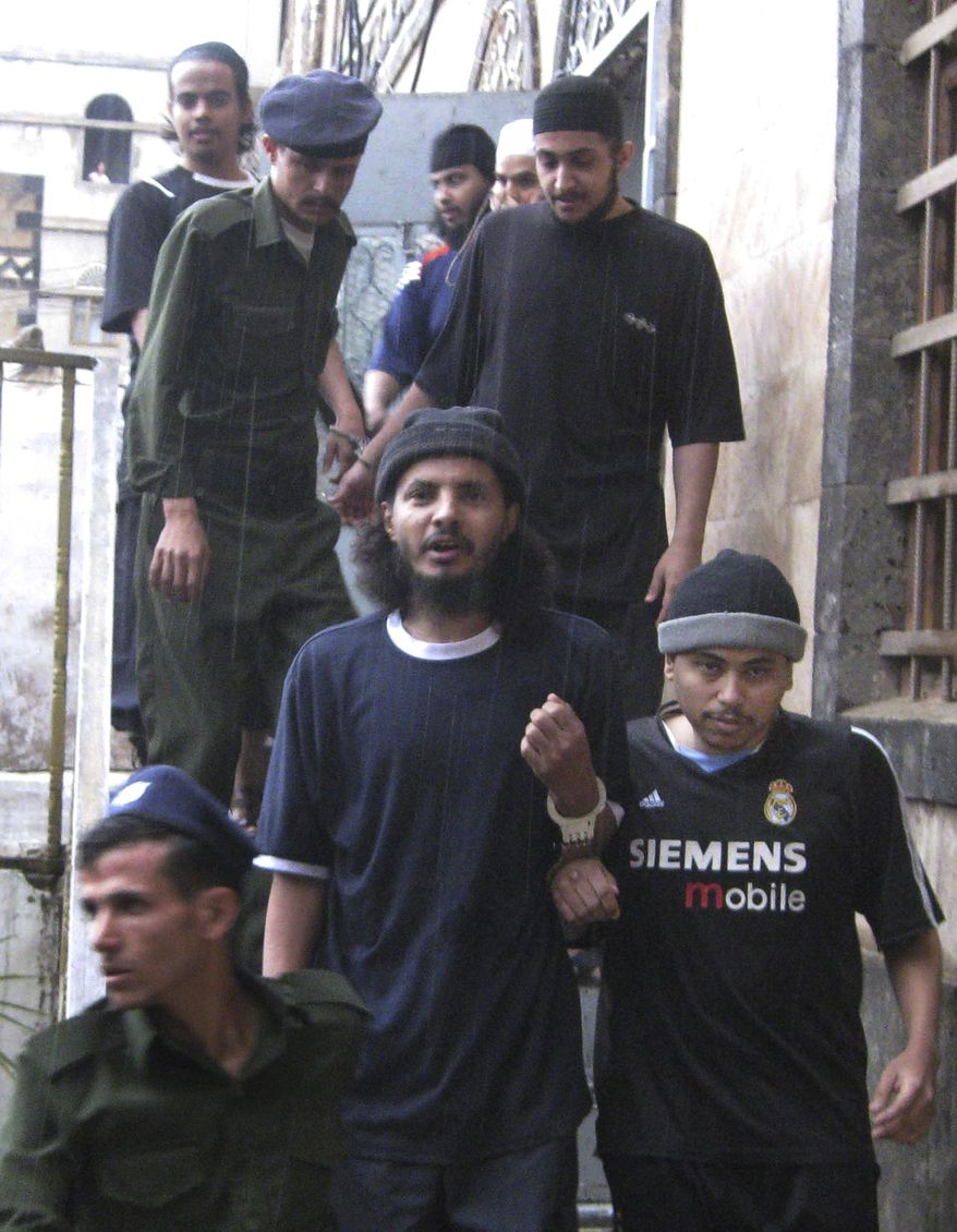 Yemeni soldiers guard convicted al Qaeda militants in San'a, Yemen, on July 11, 2010. (Associated Press) **FILE**