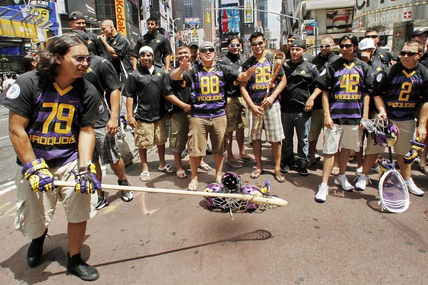 Members of the Iroquois Nationals Lacrosse team wait in New York's Times Square for their travel visas. The players cannot fly to England for the World Lacrosse Championship because the U.S. government won't allow them to re-enter the country on Iroquois Confederacy passports. (Associated Press)
