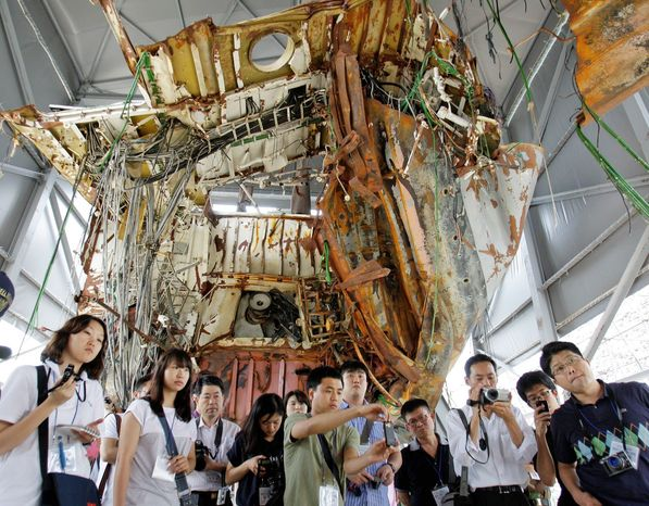 South Koreans visit the wreckage of a warship that the government says was sunk by a North Korean torpedo in March. North Korean military officers and an American-led U.N. Command will discuss the sinking of the ship on Tuesday. (Associated Press)