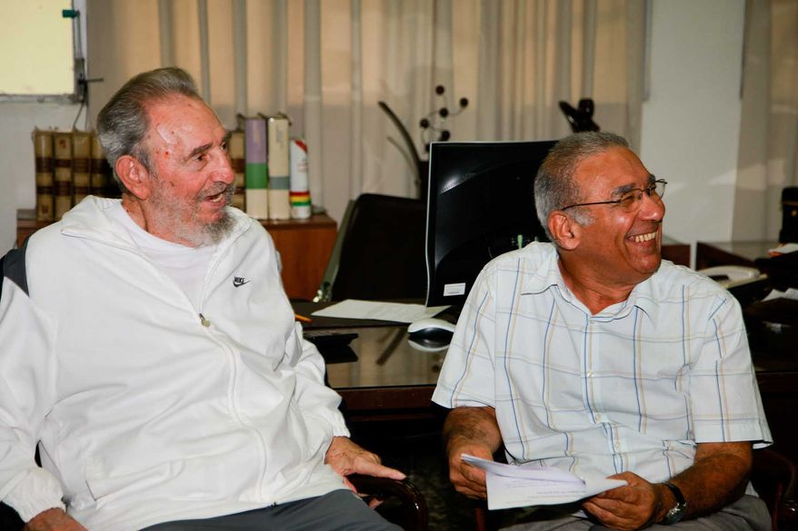 Former Cuban leader Fidel Castro (left) sits with an unidentified man during a visit to the National Center for Scientific Investigation in Havana on Wednesday, July 7, 2010. Mr. Castro had not been photographed in public since falling seriously ill in July 2006. (AP Photo/Cubadebate-Alex Castro)
