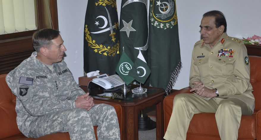 ** FILE ** U.S. Army Gen. David H. Petraeus (left) meeting with Gen. Ashfaq Parvez Kayani, the Pakistani army chief, in Rawalpindi, Pakistan, on Monday, July 12, 2010. (AP Photo/Inter Services Public Relations Department)