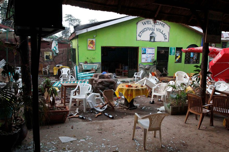 Damaged chairs and tables litter the area outside an Ethiopian restaurant that is frequented by Westerners. Near-simultaneous explosions tore through crowds watching the World Cup final at the restaurant and at a rugby club. (Associated Press)