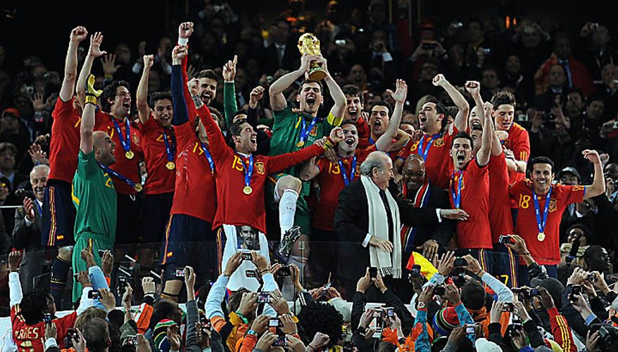 Iker Casillas of Spain lifts the World Cup following the FIFA World Cup Final match at Soccer City Stadium in Johannesburg, South Africa on July 11, 2010. (UPI/Chris Brunskill)