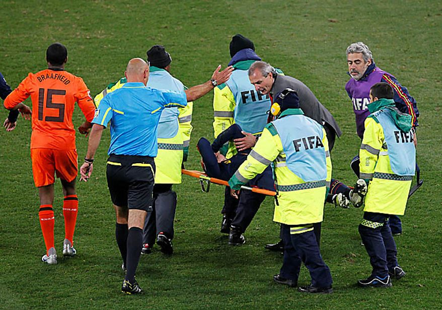 Fernando Torres is carried on a stretcher during the World Cup final soccer match between the Netherlands and Spain at Soccer City in Johannesburg, South Africa, on Sunday, July 11, 2010. (AP Photo/Eugene Hoshiko)