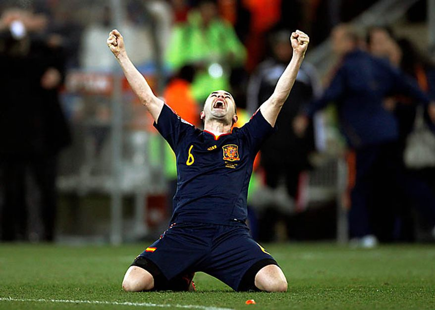 Spain's Andres Iniesta celebrates after scoring a goal during the World Cup final soccer match between the Netherlands and Spain at Soccer City in Johannesburg, South Africa, Sunday, July 11, 2010.  Spain won 1-0. (AP Photo/Luca Bruno)