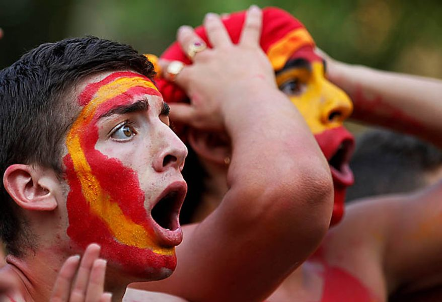 Spanish fans react during the live broadcast in Madrid of the World Cup soccer final between Spain and the Netherlands in South Africa, on Sunday, July 11, 2010.(AP Photo/Armando Franca)