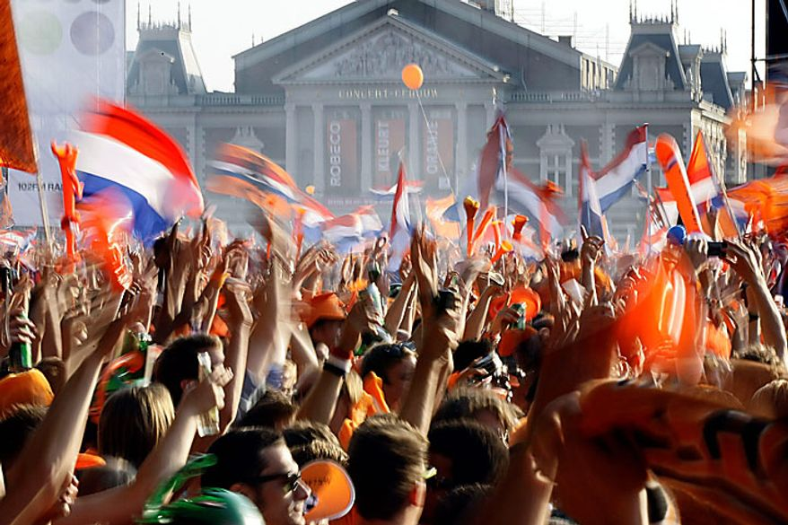 Fans of the Dutch soccer team watch the World Cup soccer final match between Netherlands and Spain in Amsterdam, Netherlands, Sunday, July 11, 2010. Spain defeated the Dutch with a 1-0 score in overtime. (AP Photo/Vincent Jannink)