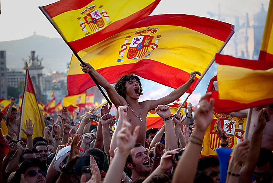 Spanish fans react as they watch in Barcelona's Plaza Espana a live broadcast of the World Cup soccer final between Spain and the Netherlands on Sunday, July 11, 2010. (AP Photo/Emilio Morenatti)