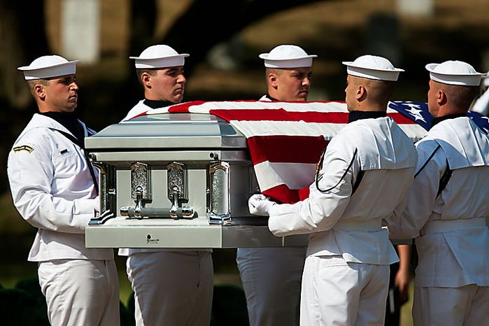 A Navy honor guard carries the casket of Navy Ensign Robert Langwell to his burial site in Section 40 at Arlington National Cemetery in Arlington on Monday, July 12, 2010. Langwell was one of two sailors missing after the USS Magpie struck a mine off the coast of Chuksan-ri, South Korea, on Oct. 1, 1950. (AP Photo/Drew Angerer)