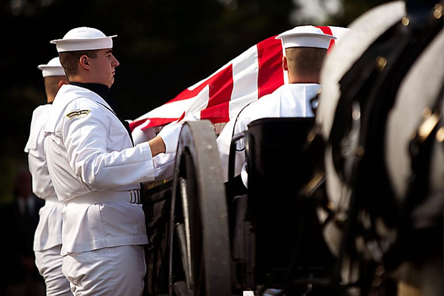 A Navy honor guard prepares to carry the casket of Navy Ensign Robert Langwell to his burial site in Section 40 at Arlington National Cemetery in Arlington on Monday, July 12, 2010. Langwell was one of two sailors missing after the USS Magpie struck a mine off the coast of Chuksan-ri, South Korea, on Oct. 1, 1950. (AP Photo/Drew Angerer)