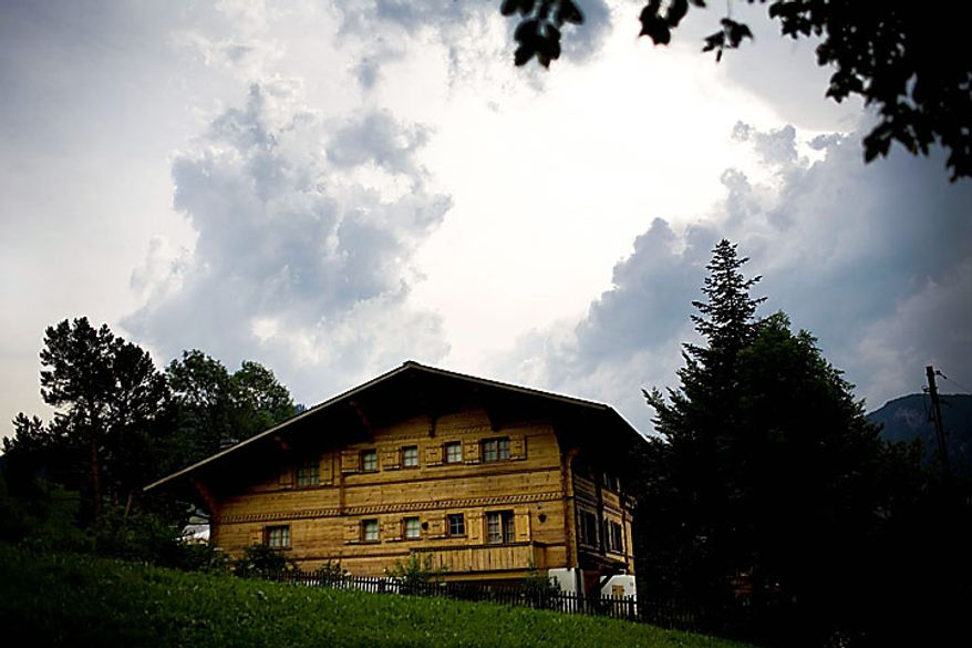 Dark clouds hang over film director Roman Polanski's chalet in Gstaad, Switzerland, on Monday, July 12, 2010. Polanski will not be extradited to the United States and was released from the house arrest in his chalet, Swiss Federal Councillor Eveline Widmer-Schlumpf said at a press conference in Bern, the Swiss capital. (AP Photo/Anja Niedringhaus)