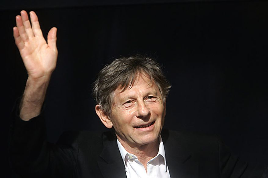 ** FILE ** French-born film director Roman Polanski waves during a media presentation in Berlin. (AP Photo/Franka Bruns, File)
