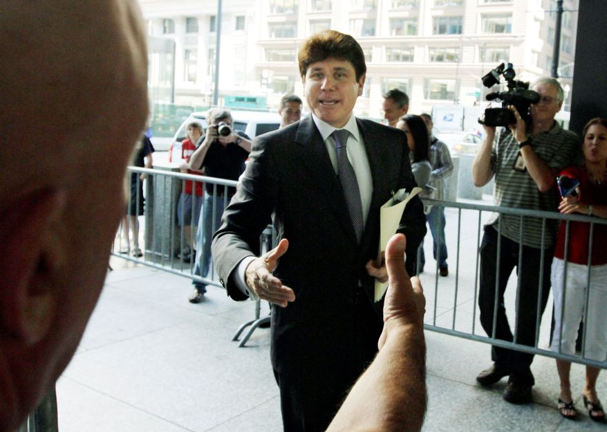 ** FILE ** Former Illinois Gov. Rod R. Blagojevich arrives at the federal courthouse in Chicago on Tuesday, July 13, 2010, for his corruption trial. (AP Photo)