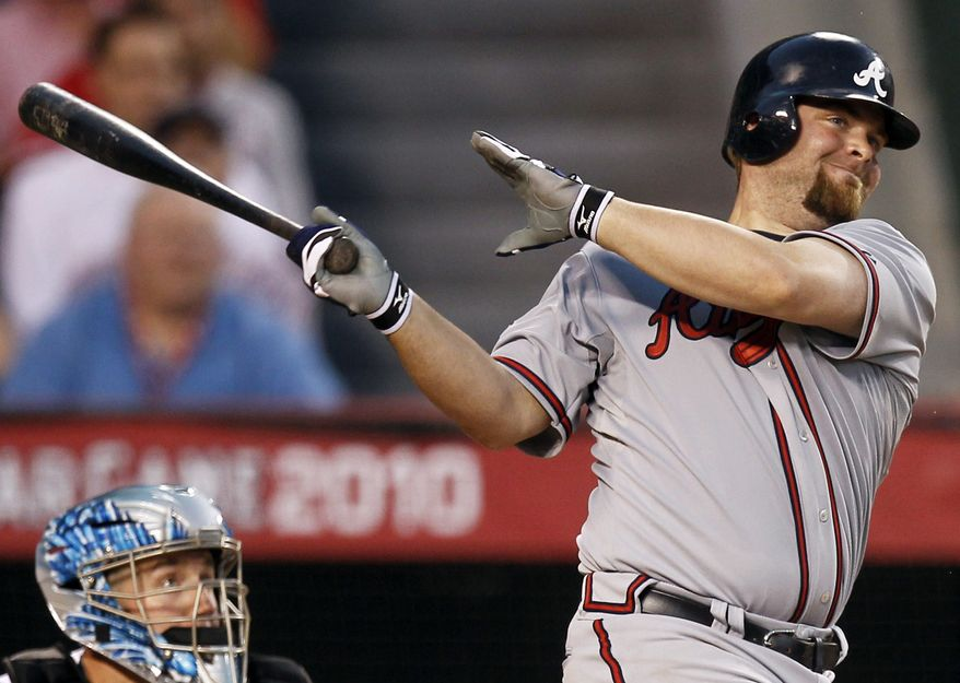 ASSOCIATED PRESS The National League's Brian McCann, of the Atlanta Braves hits a three-run double during the seventh inning of the All-Star baseball game Tuesday, July 13, 2010, in Anaheim, Calif.