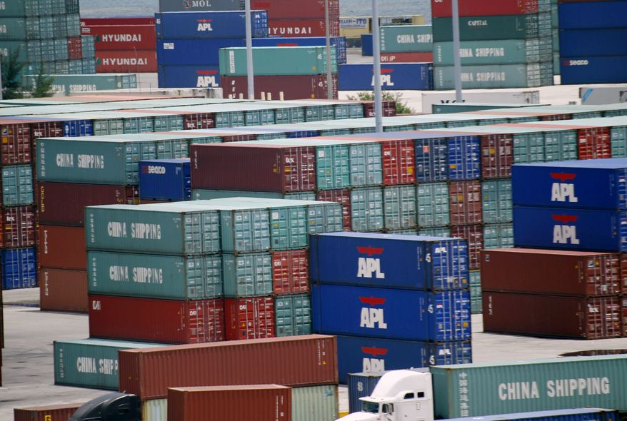 Shipping containers are stacked at the Port of Miami on Thursday, July 8, 2010. The U.S. trade deficit widened in May to the highest level in 18 months as a rebounding economy pushed up demand for imports of foreign-made cars, computers and clothing. (AP Photo/Wilfredo Lee)
