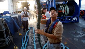 Supervisor Wade Falany handles a rope Monday while preparing for oil-skimming operations on the deck of the Pacific Responder skimming vessel in the Gulf of Mexico near the coast of Louisiana. The vessel sailed from its home port in the San Francisco Bay Area to the Gulf of Mexico to assist in the containment of oil leaking from the broken Deepwater Horizon well. (Associated Press)
