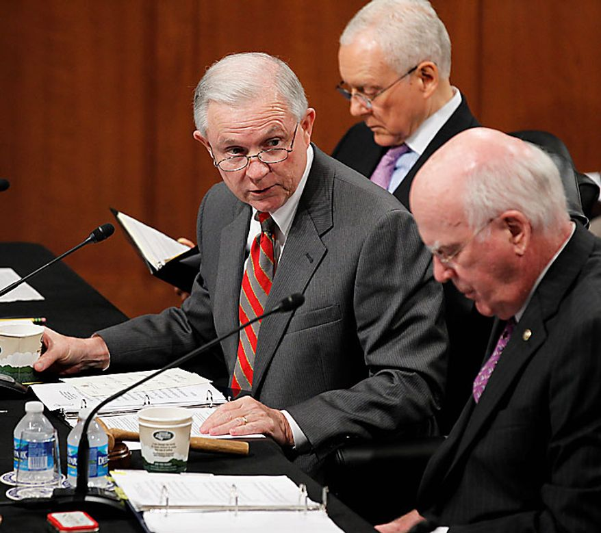 Senate Judiciary Chairman Patrick J. Leahy, Vermont Democrat, right, and Sen. Orrin G. Hatch, Utah Republican, center, listen as the committee's ranking Republican Sen. Jeff Sessions of Alabama speaks during a business meeting of the committee on Capitol Hill in Washington, Tuesday, July 13, 2010. (AP Photo/Alex Brandon)