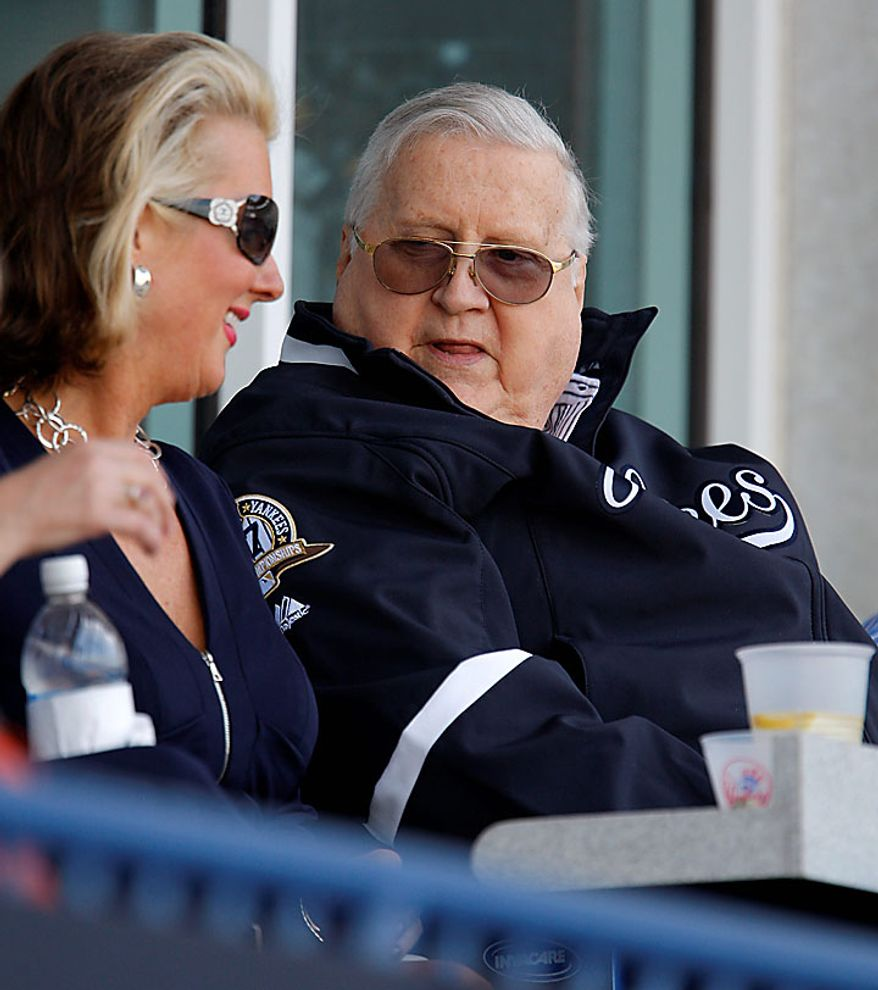 This March 8, 2010, file photo shows New York Yankees Chairman and principal owner George M. Steinbrenner (right) sitting with daughter Jennifer Steinbrenner Swindal in the family's private box and watching the Yankees defeat the Philadelphia Phillies 7-5 in a spring training baseball game at Steinbrenner Field in Tampa, Fla. A person close to George Steinbrenner says the Yankees owner died Tuesday morning, July 13, 2010. (AP Photo/Kathy Willens, File)