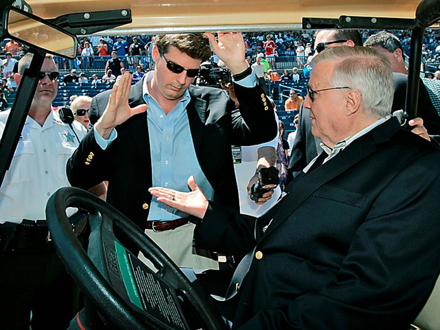 In a Thursday, March 27, 2008, photo, New York Yankees owner George Steinbrenner (right) slaps hands with his son Hal before a pregame ceremony renaming Legends Field in Tampa, Fla., as George M. Steinbrenner Field. A person close to George Steinbrenner says the Yankees owner died Tuesday morning, July 13, 2010. (AP Photo/Kathy Willens, File)