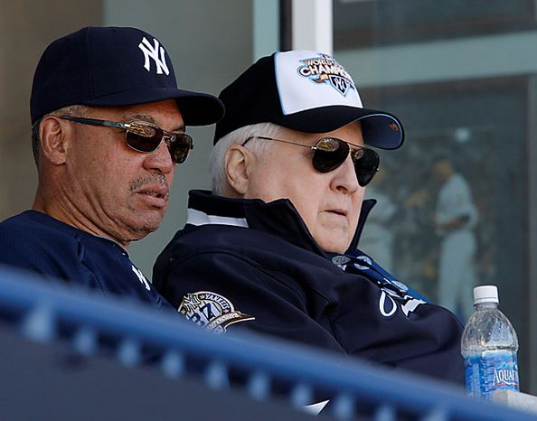 This March 6, 2010, file photo shows New York Yankees Hall of Famer Reggie Jackson (left) sitting with Yankees principal owner and Chairman George Steinbrenner during a Yankees spring training baseball game against the Toronto Blue Jays at Steinbrenner Field in Tampa, Fla. George Steinbrenner, who rebuilt the Yankees into a sports empire with a mix of bluster and big bucks that polarized fans all across America, died Tuesday, July 13, 2010. He had just celebrated his 80th birthday July 4. (AP Photo/Kathy Willens, File)