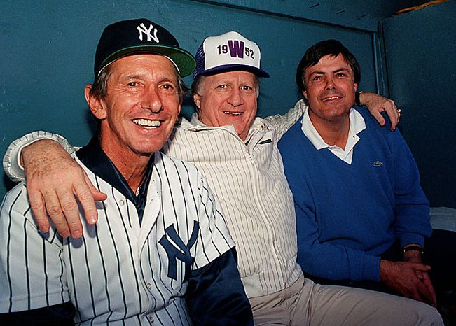 This Feb. 28, 1998, file photo shows New York Yankees owner George Steinbrenner flanked by Manager Billy Martin (left) and Vice President and General Manager Lou Piniella at spring training in Fort Lauderdale, Fla. A person close to George Steinbrenner says the Yankees owner died Tuesday morning, July 13, 2010. (AP Photo/Bill Cooke)