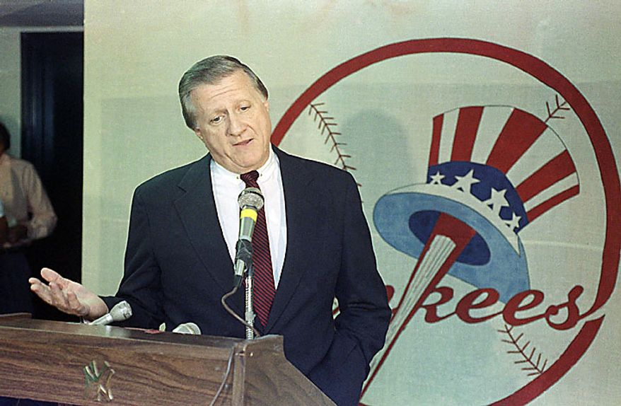In a Monday, Aug.  21, 1990, photo, George Steinbrenner gestures during a news conference after resigning as general manager of the New York Yankees at Yankee Stadium in New York. A person close to Steinbrenner says the Yankees owner died Tuesday morning, July 13, 2010. (AP Photo/Ron Frehm, File)