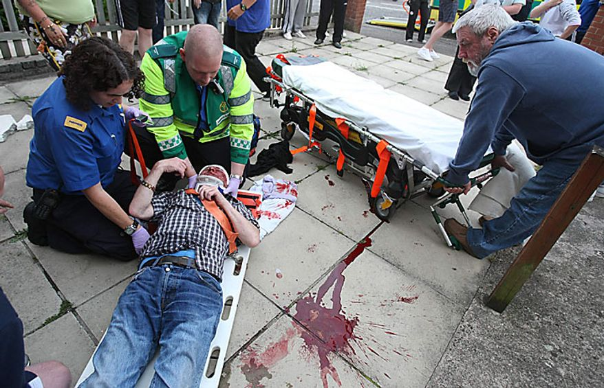A man lies injured after Nationalist protesters clashed with the Police Service of Northern Ireland in the Ardoyne Area of north Belfast, Northern Ireland, Monday, July 12, 2010. Police battled Irish nationalists for control of a Belfast road Monday as a day dominated by peaceful Protestant parades across Northern Ireland turned violent when night fell. (AP Photo)