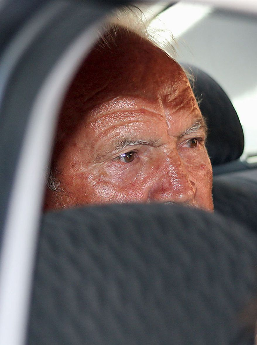 A man identified by the Italian Carabinieri (paramilitary police) as Domenico Oppedisano, considered the top boss of the powerful 'ndrangheta crime organization, rides in a Carabinieri car after being arrested in Reggio Calabria in southern Italy on Tuesday, July 13, 2010, following one of the biggest operations ever against the  'ndrangheta crime organization, in which 300 people were arrested, including top bosses, and million of dollars in property seized. The pre-dawn raids Tuesday involved some 3,000 police across the country. Charges include murder, extortion, arms and drug trafficking, and criminal association. Investigators described the operation as one of biggest blows ever to an organization that today is considered more powerful than the Sicilian Mafia. (AP Photo/Adriana Sapone)