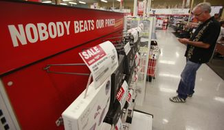 ** FILE ** Sales advertisements are on display at an Office Depot in Mountain View, Calif., on July 12, 2010. (Associated Press)
