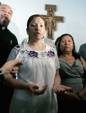 Elvira Arellano, left, an illegal immigrant from Mexico who has taken refuge in a Chicago church to avoid deportation for the last year, stands with others involved in the sanctuary movement as she answers questions at Nuestra Senora de Los Angeles church in Los Angeles Saturday, Aug. 18, 2007. (AP Photo/Reed Saxon)