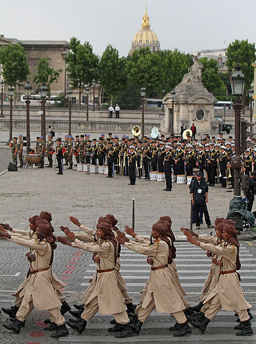 Soldiers from Chad march in the annual military parade at the Place de la Concorde during the Bastille Day celebrations in Paris on Wednesday, July 14, 2010. Leaders and soldiers from 13 former French colonies in Africa, celebrating five decades of independence, were invited to take part in this year's parade. (UPI/David Silpa)