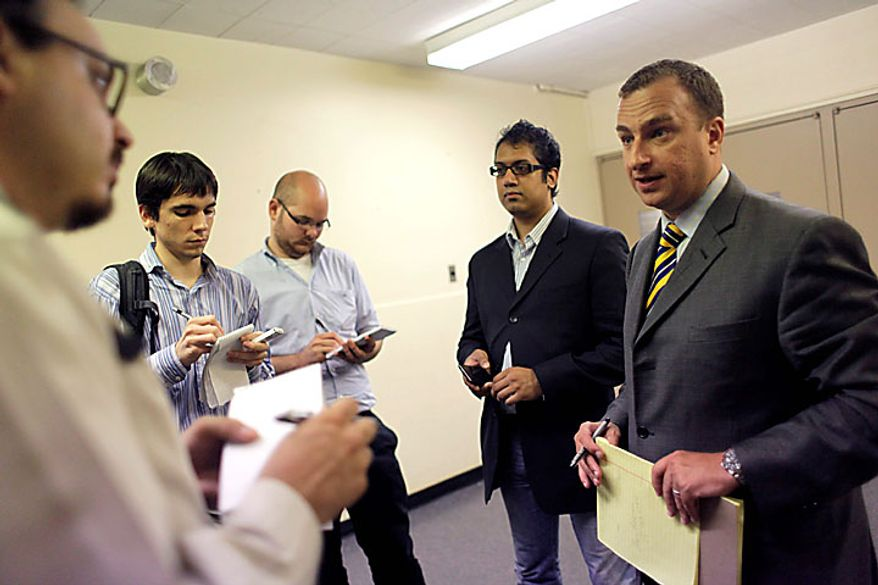 Developer Sharif El-Gamal, right, speaks to reporters during a Landmarks Commission hearing on proposal to build a mosque near the World Trade Center site, Tuesday, July 13, 2010 in New York. (AP Photo/Mary Altaffer)