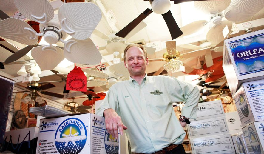 Jon Reeve, manager at Dan's Fan City, is seen at the store in Rockville, Md. on Wednesday, June 16, 2010. Ceiling fans can provide an energy-efficient supplement to air conditioning during these hot summer months. (AP Photo/Jacquelyn Martin)