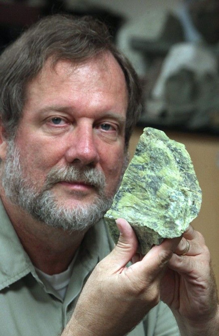 ASSOCIATED PRESS Garry Hayes, a geology teacher at Modesto City College in Modesto, Calif., opposes a proposed measure carried by a state senator that would strip the serpentine rock of it's status as the official state rock citing that serpentinite, as it is formally known, can contain asbestos.