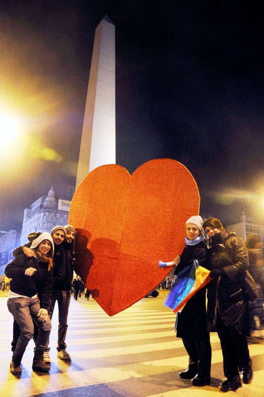 ASSOCIATED PRESS Buenos Aires' obelisk was the scene of a celebration early Thursday after Argentina became the first country in Latin America to legalize same-sex marriage.
