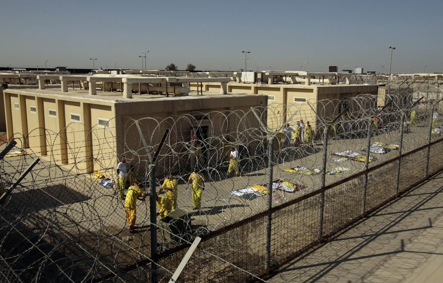 ** FILE ** In this Nov. 10, 2008, file photo, detainees are seen outside their cell block at the U.S. detention facility at Camp Cropper in Baghdad, Iraq. (AP Photo/Maya Alleruzzo, File)