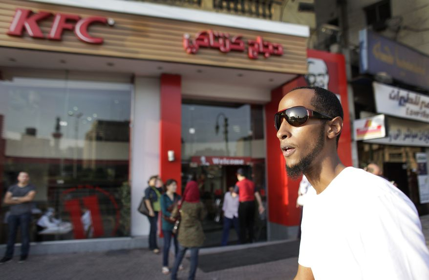Yahya Wehelie, from Fairfax, Virginia, walks in downtown Cairo, Egypt on Wednesday, June 16, 2010. Mr. Wehelie, 26, of Burke, Va., has been stuck in Egypt for more than two months but is now expected to arrive in New York Friday afternoon. (AP Photo/Ben Curtis)
