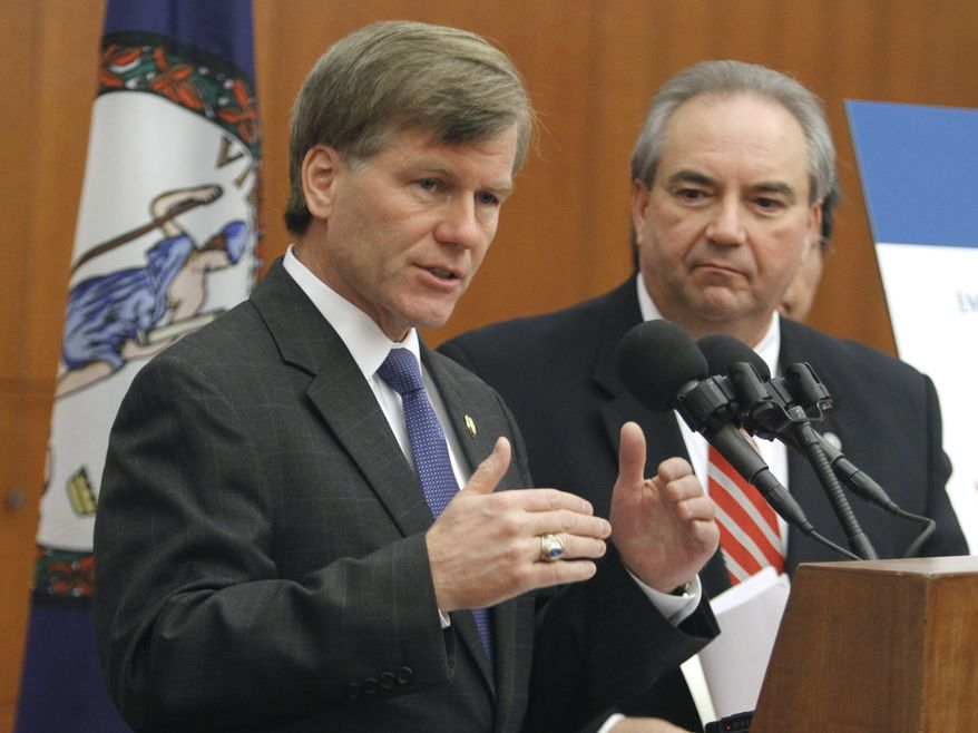 Virginia Gov. Bob McDonnell, left, gestures during a press conference along with Lt. Gov. Bill Bolling, right, at the state Capitol in Richmond, Va., Thursday, July 15, 2010. The governor said 71,500 jobs have been added in Virginia since February. (AP Photo/Steve Helber)